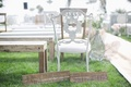White antique ceremony chair with cute wedding signs