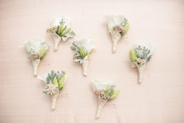 Neutral burlap wrapped boutonniere with light greenery