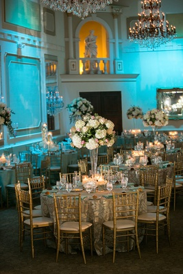 Gold chairs and chandeliers under blue lighting