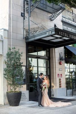 wedding portrait bride in inbal dror wedding dress fall bouquet hotel figueroa 1920s era downtown la