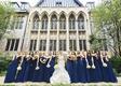bride in strapless mermaid wedding dress ruffle skirt bridesmaids in navy blue mismatch neckline