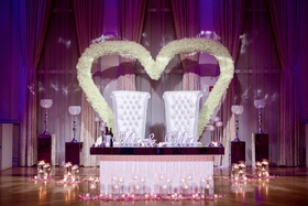 ashley alexiss wedding reception sweetheart table white tufted throne chairs white flower hearts