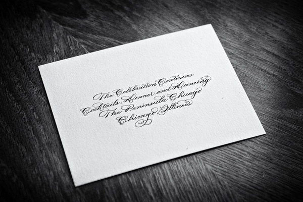 Black and white photo of reception card with calligraphy