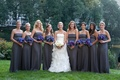 Bride with grey bridesmaid dresses and purple blue flowers