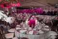 Wedding reception mirror table top velvet chairs fuchsia and hot pink orchids and flowers candles