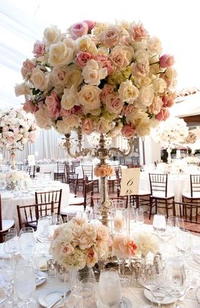 Silver candelabra wedding arrangement with blush flowers