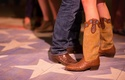 Cowboy boots with bride's monogram at welcome party