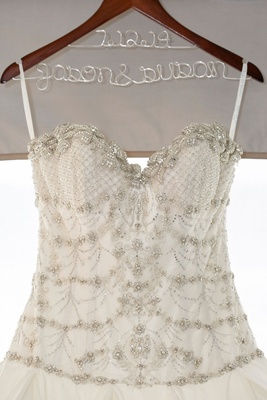 Close up of an Ines Di Santo gown with sequins, beading, crystals decorating the bodice