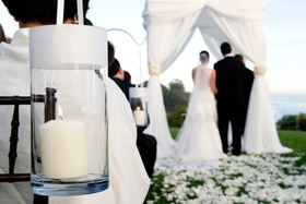 Bride and groom in background at outdoor wedding ceremony