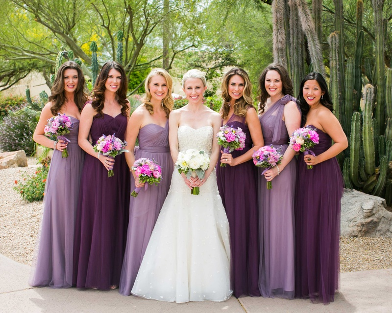 bride and bridesmaids in dresses in shades of purple violet lavender with bouquets in arizona