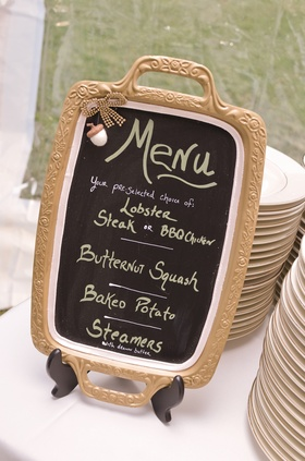 Chalkboard menu on gold tray with green marker