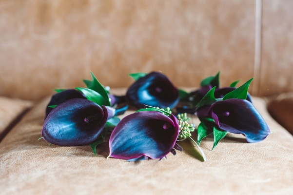 Dark purple red burgundy flower calla lily boutonnieres on seat wedding ideas