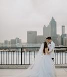 bride in tara keely ball gown wedding dress veil groom in white tuxedo jacket bow tie atlanta ga