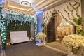 lounge seat in front of wall of ivy at entrance to reception, wedding styled shoot