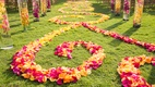 Outdoor wedding aisle with orange, yellow, and hot pink petal swirls