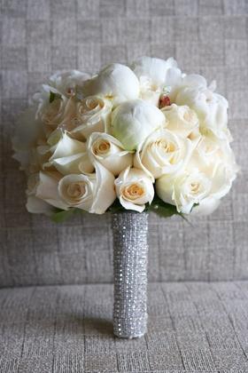 White flowers wrapped in rhinestone ribbon