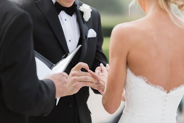outdoor wedding ceremony bride in strapless wedding dress updo groom in tuxedo bow tie vow exchange