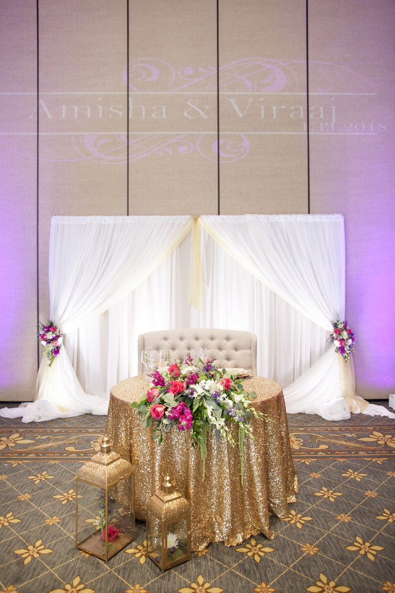 south asian wedding inspiration, gold sequin linen for sweetheart table, love seat