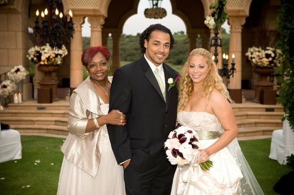 NFL player Nicholas Barnett with mother and bride