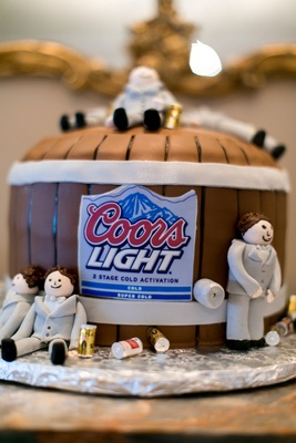 Groom's cake in the shape of a beer barrel with Coors Light label, sugar groomsmen forms in grey