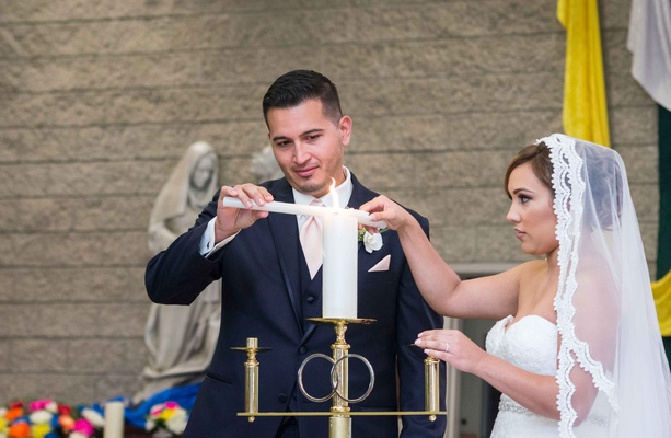 catholic bride groom light candle long veil church religious wedding california