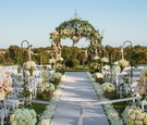 Floral-embellished chuppah and aisle markers