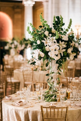 gold chairs white orchid rose hydrangea lily centerpiece arrangement classic wedding decor ideas