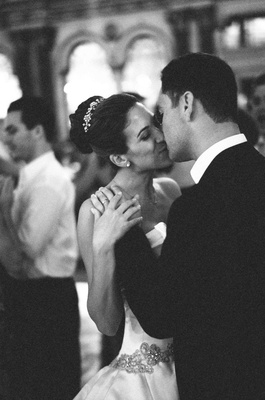 Black and white photo of couple kissing