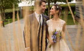 Nikita actors Lyndsy Fonseca and Noah Bean wedding day purple bouquet flowers in hair vineyard