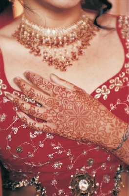 Indian Wedding Attire Henna Tattoo Art On Brides Hand Over Bodice