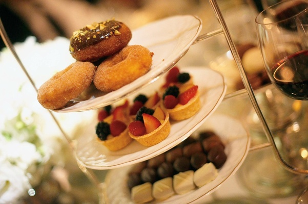 Plates of donuts, tarts, and chocolate truffles