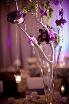 Fluted vase filled with floral-embellished branch