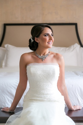 bride posing on bed accessories silver shiny classic diamonds crystals wedding