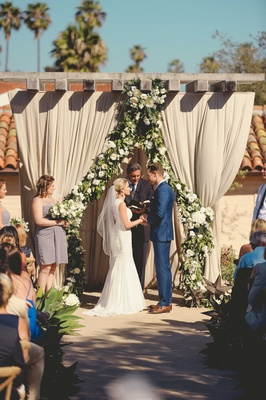 Jenna Reeves and Plain White T's singer Tim Lopez at outdoor Santa Barbara wedding ceremony drapery