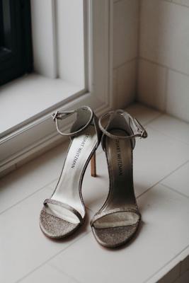 Suzanna Villarreal and Alex Wood LA Dodgers wedding shoes stuart weitzman strap sandal silver