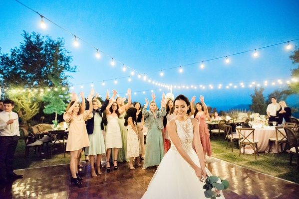 Outdoor wedding reception patio string lights bistro bride bouquet toss megan nicole youtube singer