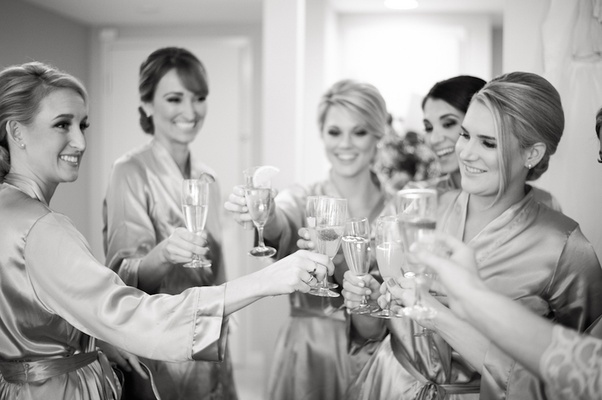 Black and white photo of women holding Champagne