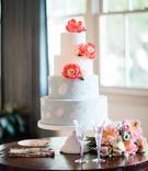 wedding cake four layer white round pastel blue pink flower coral peony sugar flowers