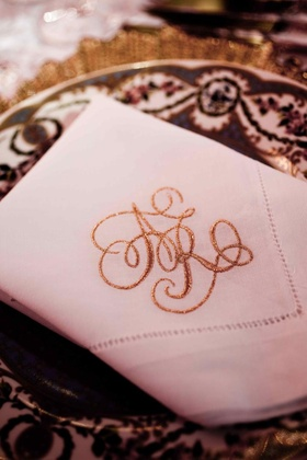 White linen napkin with sparkling gold monogram initials