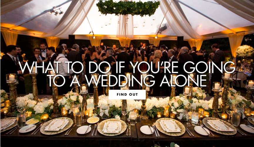 black-tie tented wedding reception with drapery, chandelier of greenery, large golden candlesticks