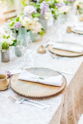 rustic wedding outdoor venue italy destination wedding wood charger with beaded rim pottery favor
