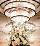 centerpiece with garden roses, hydrangeas, ranunculus, eucalyptus stems and seeded eucalyptus