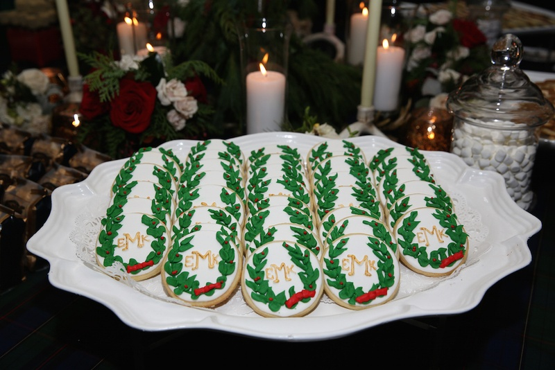 Christmas sugar cookies with wedding monogram, holly decoration for holiday theme wedding