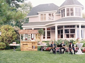 Marriott family lake house with fresh lemonade wood stand musicians in chairs ice tea