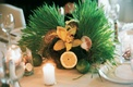 Small centerpiece with grass, lemon, lime, orchid, and sea shell decorations