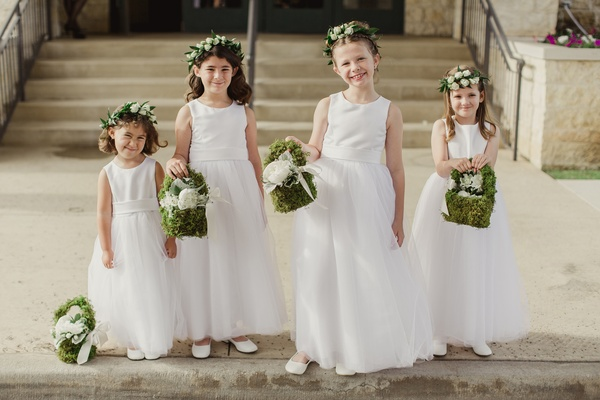 flower girls with flower crowns and moss baskets