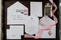wedding invitation with die cut letterpress invite and weekend itinerary with rsvp card, calligraphy