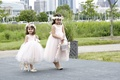 Two girls in pink flower girl dresses with flower crowns