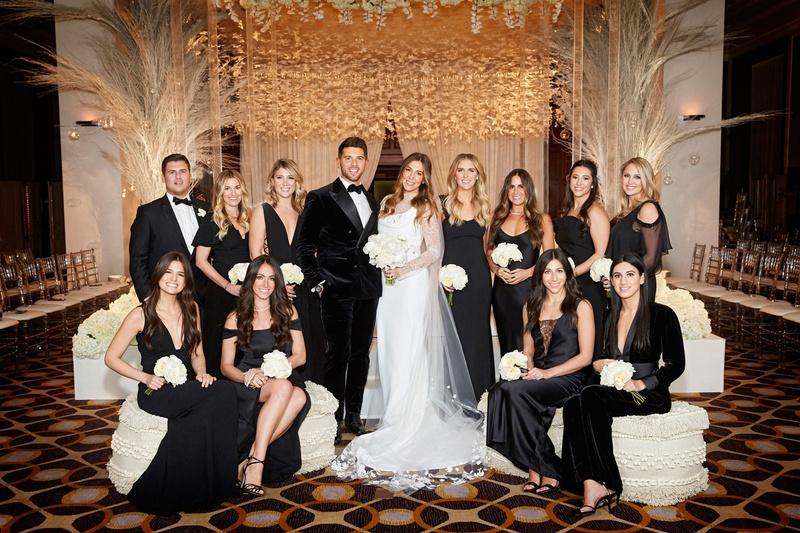 bride in vera wang wedding dress groom velvet tuxedo bridesmaids in black mismatch dresses ceremony