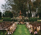 Stephanie Perez and Brandon Hampton wedding ceremony outdoor at greystone mansion flowers foliage
